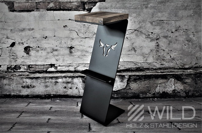Black designer bar stool for interior made of wood and metal