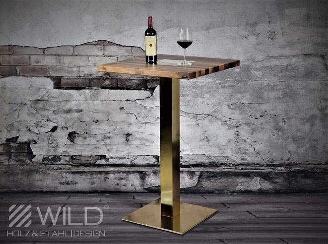 Designer furniture, home accessories and luxury chalet furnishings by WILD DESIGN golden line. A stainless steel bar table in gold for outdoor use or for the terrace.