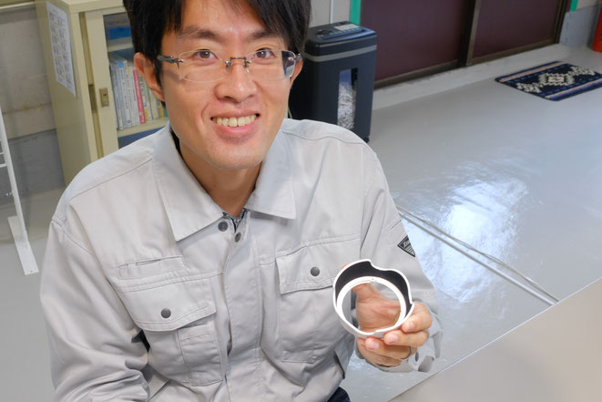 a man holding white lens hood with anti-reflection kit