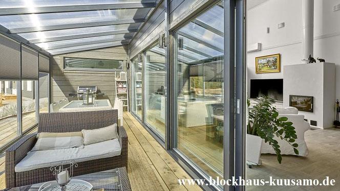 Blockhaus mit Wintergarten