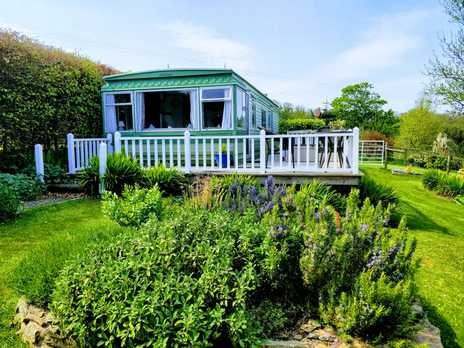 The Caravan with views over the wildlife pond and onto the lighthouse.