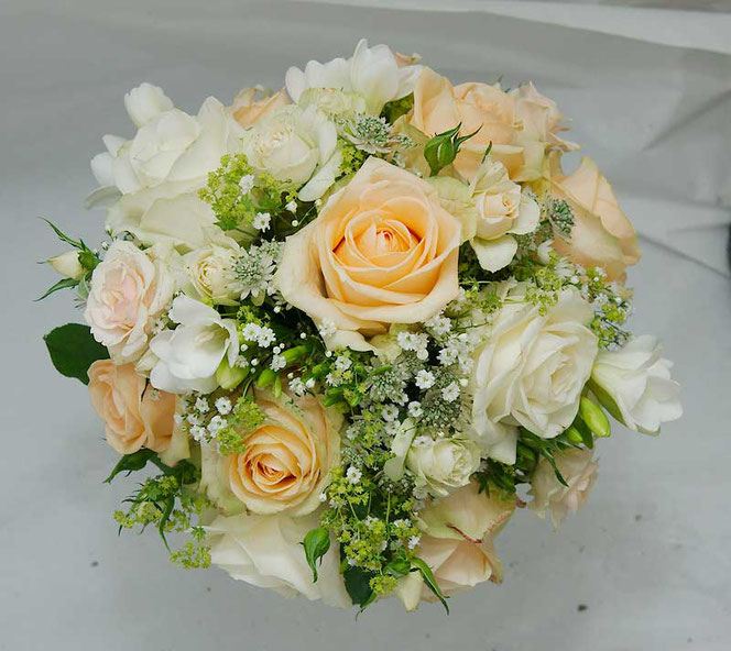 wedding bouquet with white and peach roses
