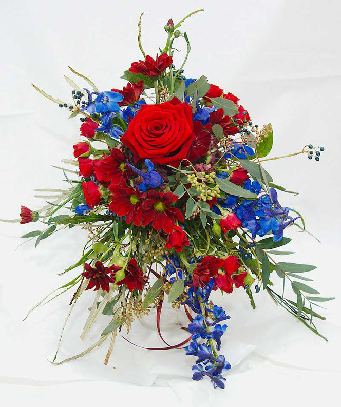Bridal bouquet cascade style in strong colours