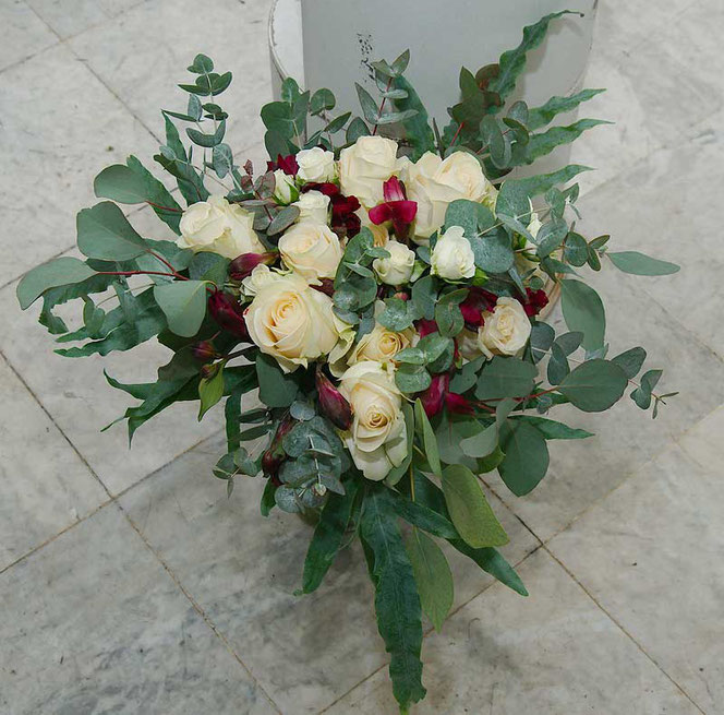 wedding bouquet with cream roses, dark red flowers and eucalyptus in vintage style vienna