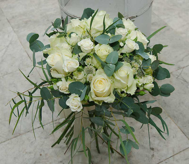 wedding bouquet with white roses and eucalyptus in vintage style vienna