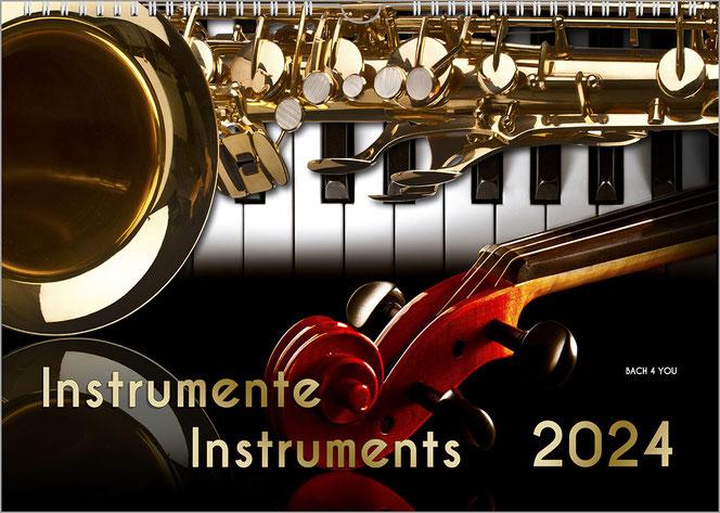 """Musikergeschenk Musik-Kalender: Oben links ist das große Kalender-Motiv, eine Traumorgel in Gold- und Weißtönen. Rechts ist das Kalendarium von oben bis unten. Unten im Bild ist der Titel: Die schönsten """"Orgeln der Welt""""."""