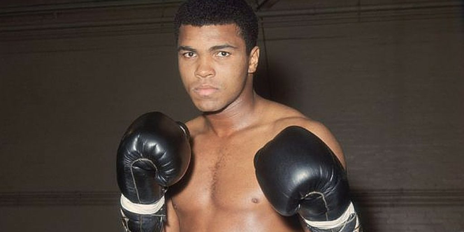 Picture of Muhammad Ali in Boxers shorts & gloves.