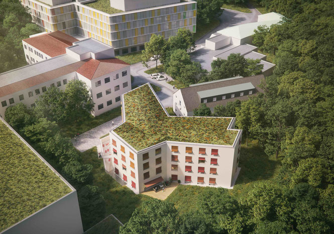 Luftansicht des Familienhauses mit dem ELKI oben im Hintergrund. Direkte Nähe der Familien zu Ihren Kindern im Krankenhaus.
