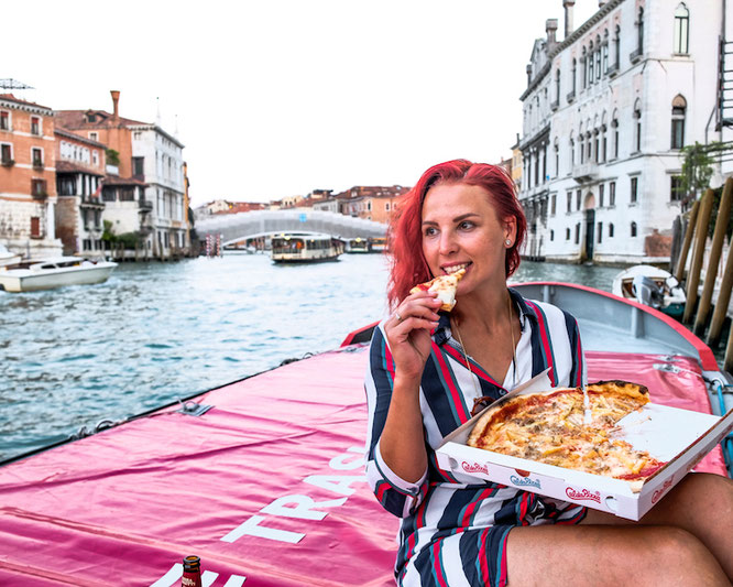 Eating pizza in Venice, Italy
