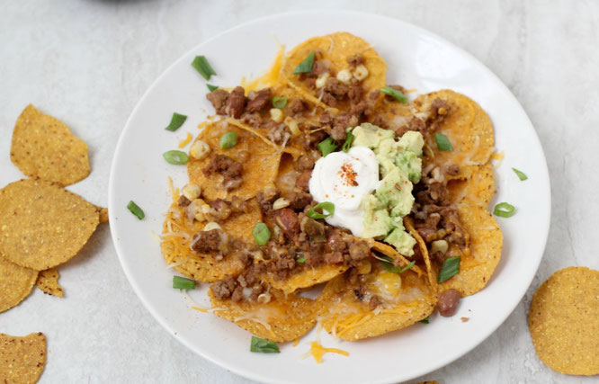 Looking for the perfect football-watching snack?  These crowd-pleasing taco nachos are a little lighter than your typical party snack, but are still full of flavor and protein!