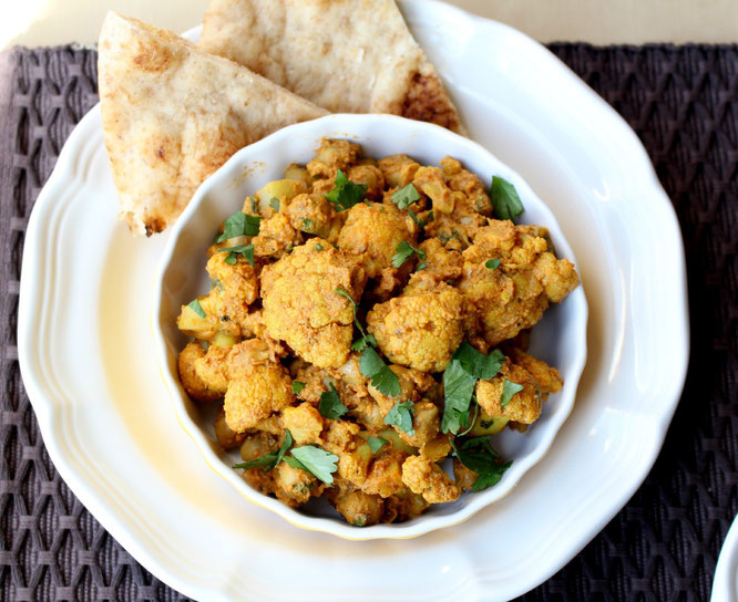 Vegan Cauliflower and Chickpea Curry with cocunt milk, ginger, garlic, and amazing Indian spices!  This one-skillet dinner is ready in under 30  minutes! - by homemade nutrition - www.homemadenutrition.com