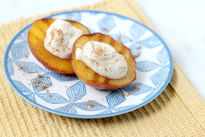 Four ingredients is all it takes to make this perfect summer dessert of grilled peaches with sweet Greek yogurt and cinnamon! - www.homemadenutrition.com