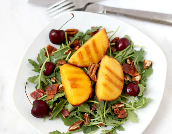 Nothing says summer like this salad!  Grilled peaches, fresh cherries, pecans, and bacon make for the ultimate combination of sweet and salty flavors. - www.homemadenutrition.com