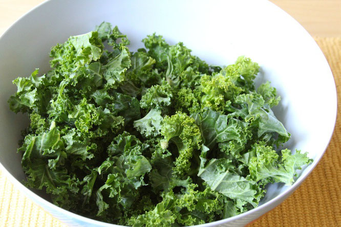 Fresh kale already cut into pieces and ready for oil, seasonings, and baking for kale chips!
