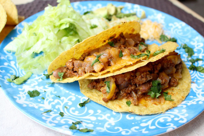 Easy, cheesy beef tacos are so simple to make with just a few healthy ingredients and about 20 minutes total.  Easy high protein, gluten free weeknight dinner! www.homemadenutrition.com