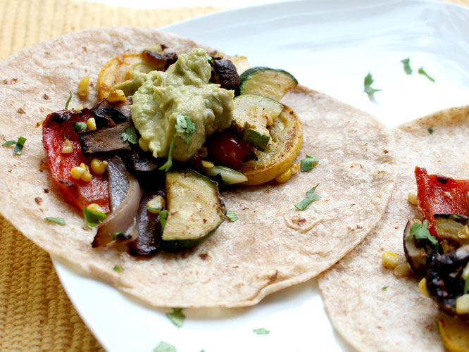 Vegan grilled veggie tacos are perfect for a light spring or summer dinner!  These can also be made in the oven and keep very well as leftovers - www.homemadenutrition.com