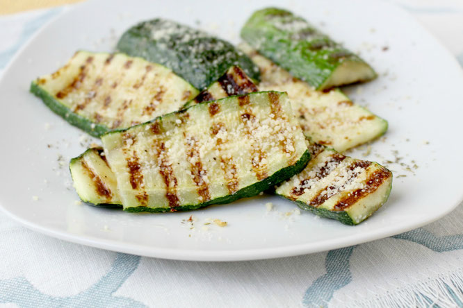 Grilled parmesan zucchini is one of the best ways to enjoy this delicious family-friendly veggie.  This recipe has only 5 main ingredients and comes together in minutes!  You can also use this several different ways.  www.homemadenutrition.com