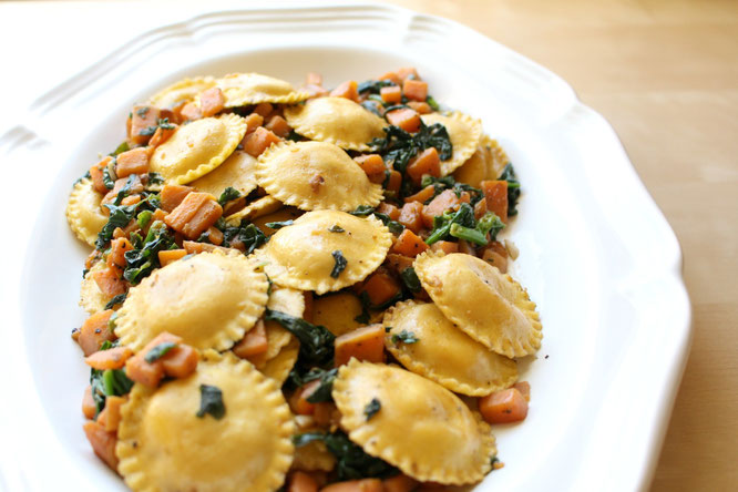 Beautiful vegetarian dish with ravioli and garlicky sauteed sweet potatoes and spinach.  Perfect flavor combinations! - by homemade nutrition - www.homemadenutrition.com