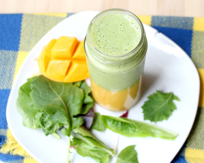 This layered smoothie has a sweet mango-banana base with an apple, greens, and tea smoothie on top.  It's a whole new world of flavor with two smoothies in one! - www.homemadenutrition.com