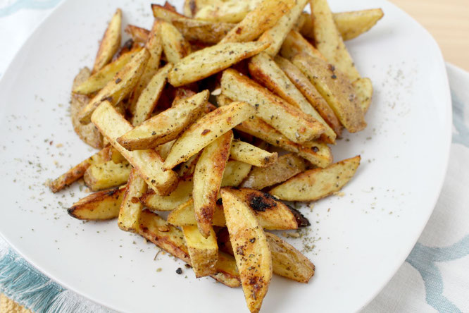 These easy baked french fries have all of the texture and flavor you'd expect from regular fries, but are a much lighter alternative.  Healthy and family-friendly side dish!