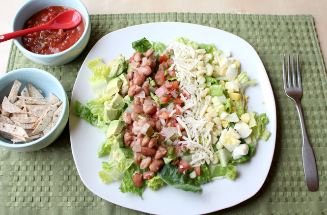 Avocado, cheese, pico de gallo, beans, corn, and hard boiled egg make this salad beautiful, flavorful, and healthy! - www.homemadenutrition.com