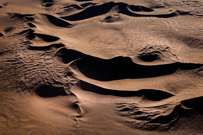 Red sand dunes in the areas of Sossusvlei - bird`s eye view, scenic flight - Namib Desert Namibia
