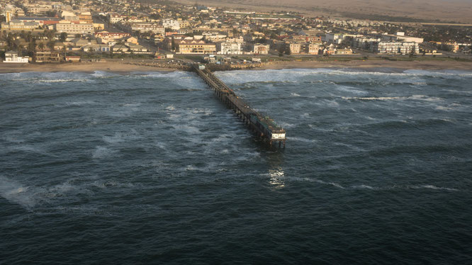 Bird`s eye view scenic flight famous landmark the jetty (built in 1905) of Swakobmund - Namib Desert Namibia