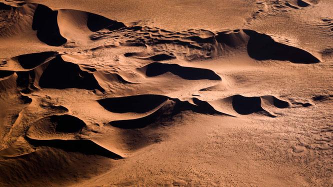 Red sand dunes in the areas of Sossusvlei - bird`s eye view, scenic flight - Namib Desert Namibia