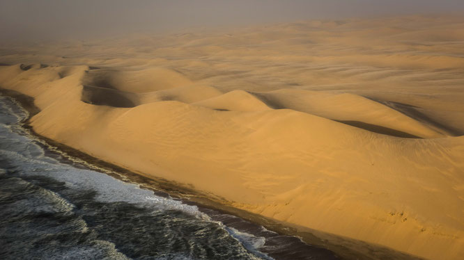 Bird`s eye view scenic flight - the long wall, Namib Desert meets the Atlantic Ocean, Namibia