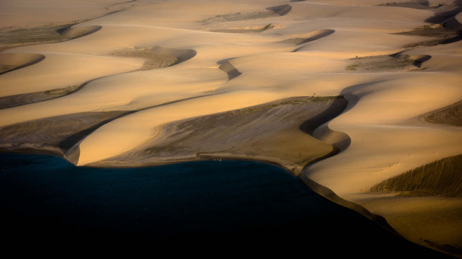 Bird`s eye view, the Atlantic Ocean meets the Namib Desert in Namibia, a confusing picture