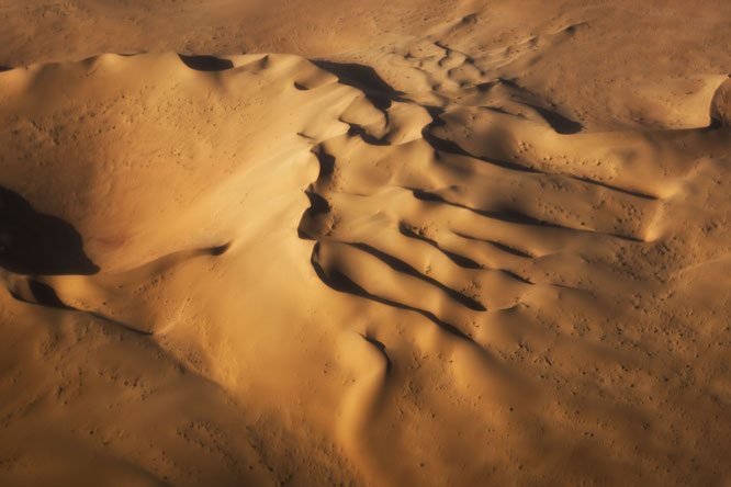 Red sand dunes in the areas of Sossusvlei - bird`s eye view scenic flight - Namib Desert Namibia
