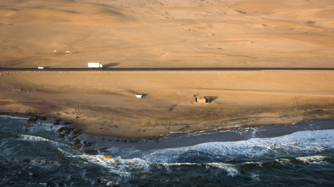 Bird`s eye view, scenic flight - coastal street between Swakobmund and Walvis Bay - Namib Desert Namibia