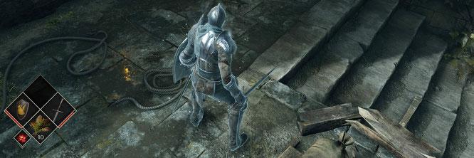 """Auch kleine Details erfreuen das aufmerksame Spieler-Auge. Darunter der geschickt gesetzte Fackelwiderschein in einer Pfütze (""""Demon's Souls"""")"""