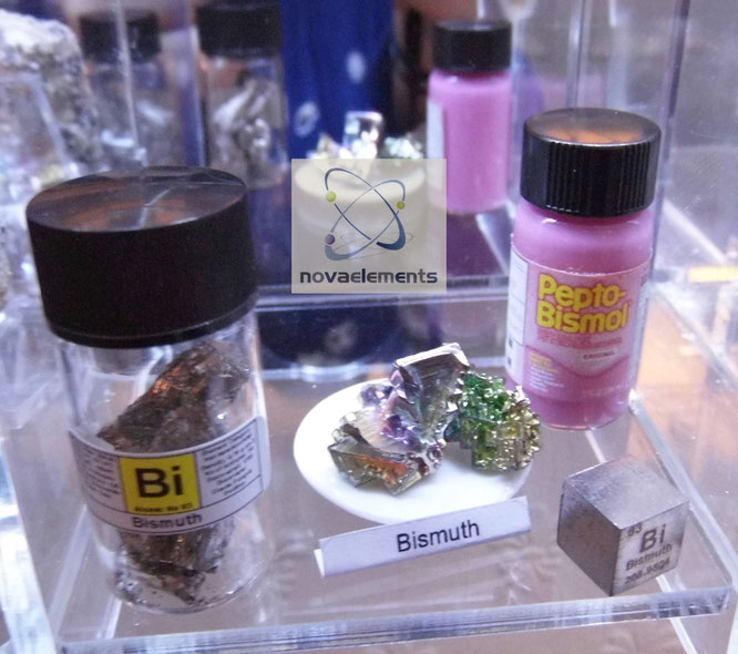 bismuth metal sample displayed with a bismuth cube, bismuth crystal, bismuth vial, pepto-bismol