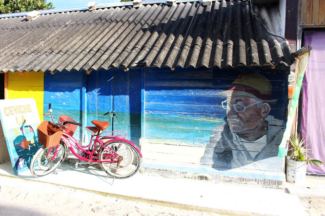 Old man and bikes in Holbox