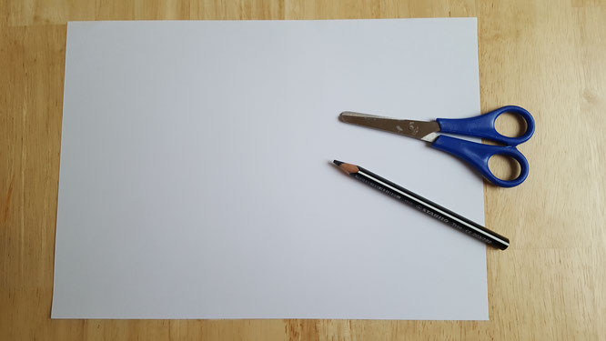 Das Material für ein Papier-Gespenst: weißes Blatt Papier, schwarzer Buntstift, Schere