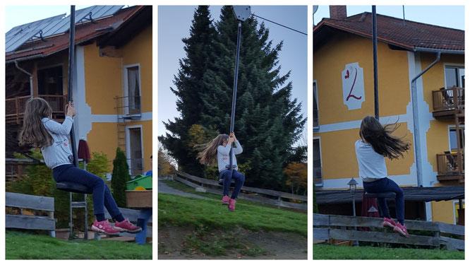 Unsere Kleine schwebt mit der Seilbahn den Hang hinab