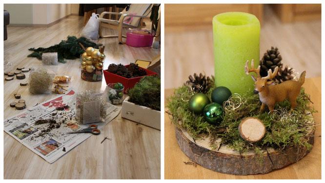 Gesteck mit Hirsch und Moos auf einer Holzscheibe