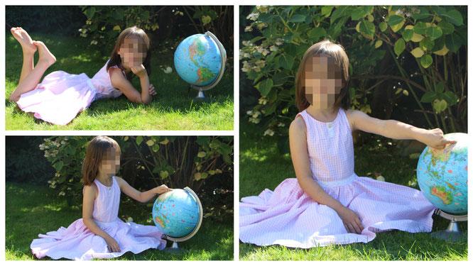 Unser Schulkind mit dem Globus