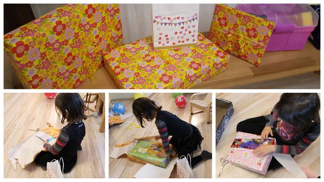 Unsere Große packt voller Eifer ihre Geburtstagsgeschenke aus