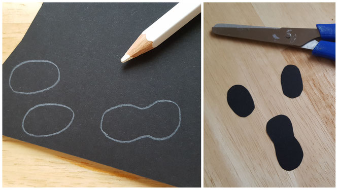 Das Gesicht für das Becher-Gespenst aus schwarzem Tonkarton
