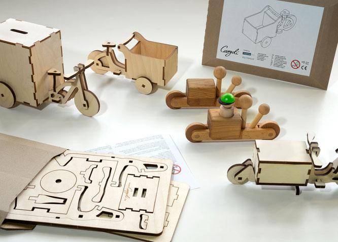 Die Cargolis gibt es als Bausätze aus gelasertem Birkensperrholz und als Kleinkindvariante aus Vollholz.
