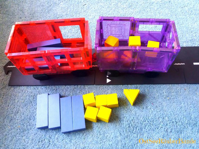 Spielidee für das Transport Schema: Fahrzeug und Ladung zum Einladen und Transportieren