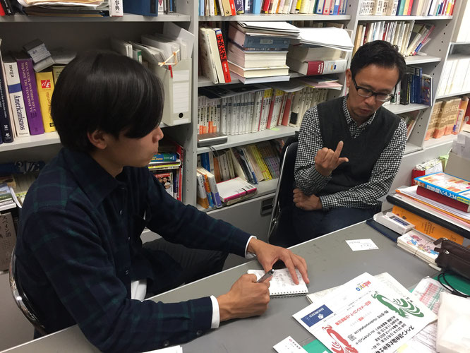 Prof. Hideki Takamatsu (right) speaks during an interview with Hakumon Herald at his office.