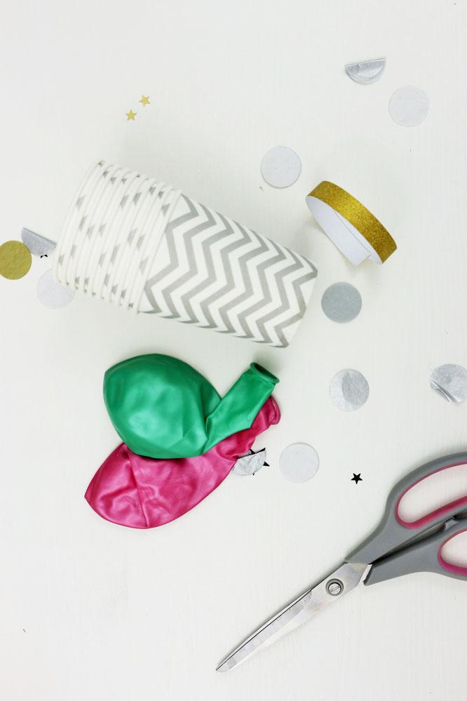 BIld: DIY Konfetti Kanonen und Konfetti Popper ganz einfach aus Pappbechern selber machen, einfache Konfetti Kanone für Silvester, zur Hochzeit, zum Geburstag und zum Feiern; gefunden auf www.partystories.de