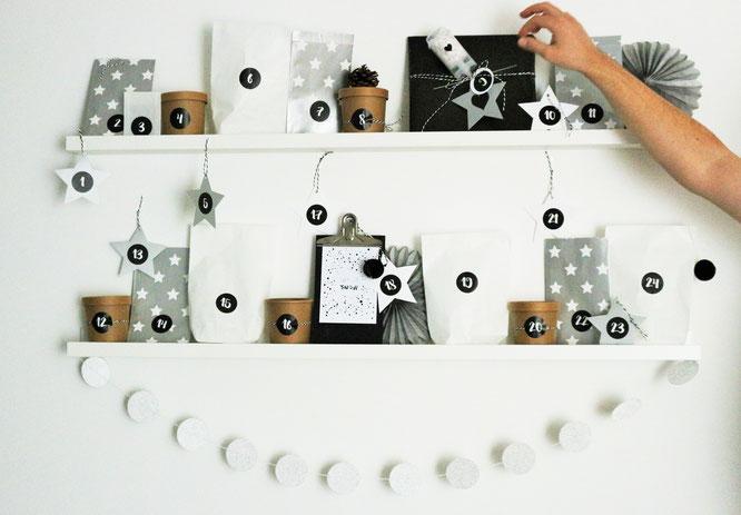 Bild: Diese DIY Adventskalender Idee für ihn mit Freebie Gutscheinen zum Ausdrucken und Verschenken, Adventskalender ganz schnell und einfach selber basteln; gefunden auf www.partystories.de mit Bastelutensilien von www.miomodo.de