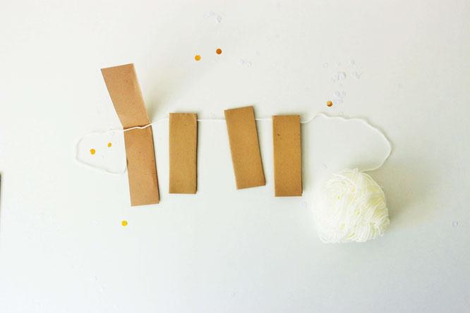 Bild: DIY Deko Girlande für die Party oder Hochzeit aus Papier gestalten - mit dieser Anleitung ganz einfach eine schöne Partygirlande für jeden Anlass basteln! // gefunden auf dem DIY & Kreativ Blog Partystories.de // #diygirlande #Girlande #Partydeko