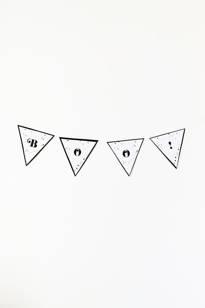 Bild: DIY Halloween Party Deko Ideen: Mit dieser Freebie Bastelvorlage Girlanden als Dekoration für Halloween & die Halloween Party einfach aus Papier selber machen! // Bastelvorlage & Anleitung von partystories.de // #halloween #halloweenparty #diydeko