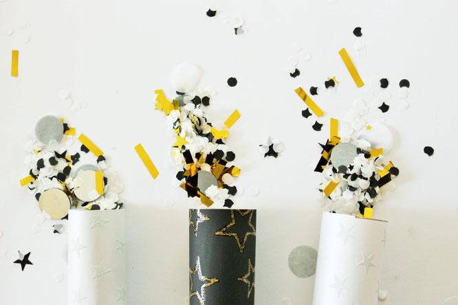Bild: DIY Konfettikanonen aus Papierrollen und Geschenkpapier für die Party oder Silvester einfach selber machen - Anleitung von Partystories.de // #Konfettikanone #Silvester #partydeko #Konfetti #bastelnmitKindern