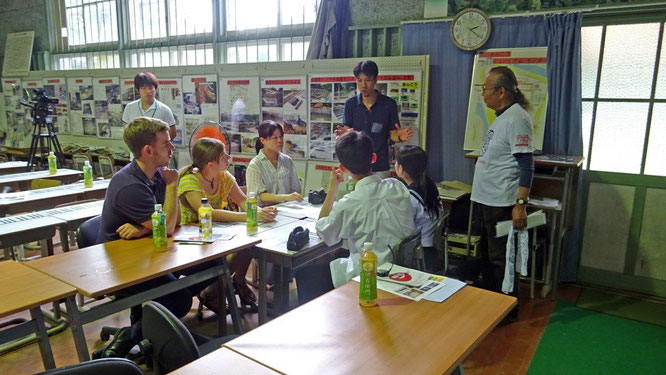 Students from Ikuno High School learning about the ecology and the conservation issues surrounding the local giant salamander populations at the Hanzaki Institute (Mr. Tochimoto on right)